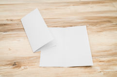 Bifold white template paper on wood Stock Photos