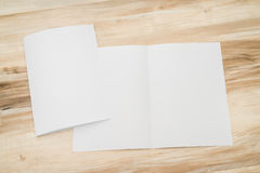 Bifold white template paper on wood Stock Photography