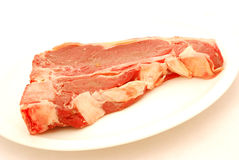 Bifteck à l'os cru Photo stock