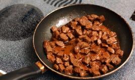 Bifteck dans le Skillet Photographie stock libre de droits