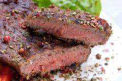 Bifteck de bande d'aloyau avec la pomme vapeur Image libre de droits