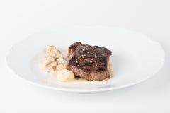 Bifteck de boeuf avec des champignons Photo libre de droits