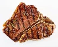 Bifteck de boeuf grillé épais juteux d'à l'os Photographie stock libre de droits