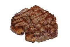 Bifteck de boeuf juteux d'isolement de nervure-oeil photo libre de droits