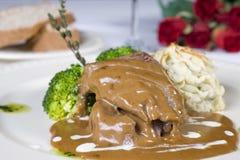 Bifteck de chameau en sauce au jus à la carte Photographie stock libre de droits