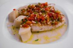 Bifteck de merluches avec le vinaigrette de poivre Photographie stock