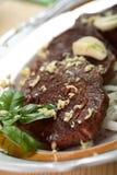 Bifteck de porc avec l'ail Images libres de droits