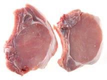 Bifteck de porc avec une pierre images stock