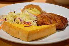 Bifteck de porc de poivre noir, menu délicieux Images libres de droits