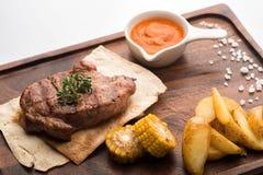 Bifteck de porc sur un pain pita Photographie stock libre de droits