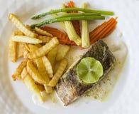 Bifteck et Français de poissons frits Image stock
