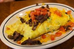 Bifteck et omelette de Tomatoe photos stock