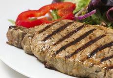 Bifteck et salade image stock