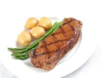 Bifteck grillé - boeuf juteux images stock