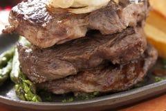Biftecks triples Images stock