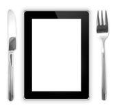 Bifurcación con un cuchillo cerca de la tableta. comput comestible de la tableta Foto de archivo libre de regalías