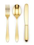 Bifurcación, cuchara y cuchillo de oro Imagen de archivo libre de regalías