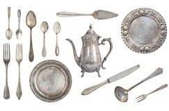 Bifurcaciones de la plata del vintage, cucharas, cuchillos, caldera, placas, cucharón y imagen de archivo libre de regalías