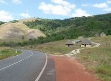 Bifurcation. Route to enter small village in the great Venezuelan savannah Royalty Free Stock Photography