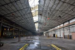 Big abandoned hall. Big hall  in an old abandoned factory Stock Images