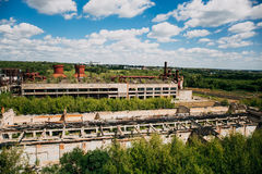 Big abandoned industrial factory or plant Overgrown with wood, ruined buildings. Aerial panoramic view of big abandoned industrial factory or plant area Royalty Free Stock Photos