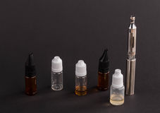 Big advanced electronic cigarette. Located on a black background stock images