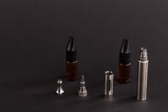 Big advanced electronic cigarette. Located on a black background stock photography