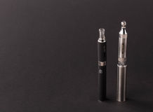 Big advanced electronic cigarette. Located on a black background royalty free stock photo