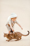 Big advantures in desert. Concept of travel and fascinating adventures. hild in suit of treasures seeker like Indiana Jones in the desert whit wild cat similar stock photo