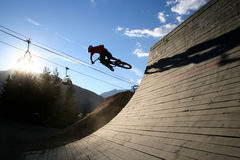Big Air. A freerider launches himself off a quarterpipe and into the sunset royalty free stock photo