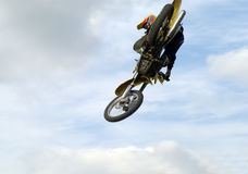 Big air. Big jump over my head. To take this picture i must lay on the table top and the motobike jump over me. oh i like it Stock Photos