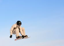Big Air. Snowboarder jumping royalty free stock photos