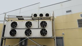 Big air conditioner equipment or ventilation system outside the building supermarket or shopping mall. Large stretching