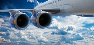Big airliner. In the blue sky with clouds royalty free stock photos