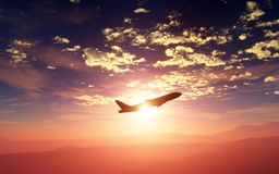 Big airliner flying at sunset or sunrise over a beatiful landscape of mountains. 3D illustration royalty free stock photo