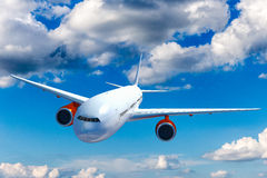 Big airplane above the clouds. Royalty Free Stock Image