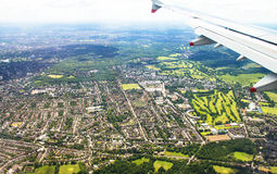 Big airplane  begins to decline and prepares for landing in Heathrow Airport . London. UK Royalty Free Stock Photo