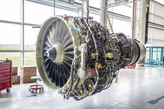 Big airplane engine during maintenance. An airplane engine during maintenance in a warehouse Stock Images