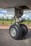 Big airplane wheels and landing gear Royalty Free Stock Photo