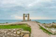 Big alarm bell. The ruins of ancient Greek city of Chersonesus Taurica in the Crimea peninsula under the cloudy sky Royalty Free Stock Images