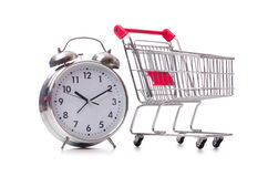 The big alarm clock in shopping cart on white Stock Photography