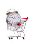 The big alarm clock in shopping cart on white Royalty Free Stock Images