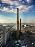 Big Alice. Rooftop view of industrial smoke stacks with river in the background Stock Images