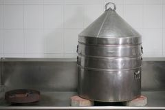 Big aluminium steamer on gas stove with red brick Royalty Free Stock Photography