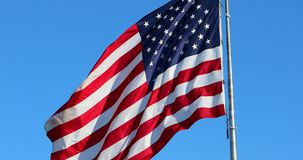 Big American Flag Waving In The Wind stock video footage