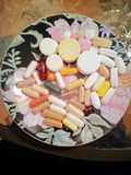 Big Aminos 1. Plate filled with multicolored vitamkns Stock Photography