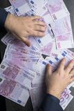 Big amount of Five hundred notes of European Union Currency. Man put hands on the 500 euro notes Stock Images