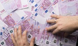 Big amount of Five hundred notes of European Union Currency. Man put hands on the 500 euro notes Stock Photography