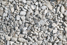 The big amount of light grey stones laying on the ground royalty free stock image
