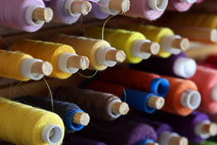 A big amount of spools with colorful threads Stock Photo